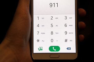 Cellphone in hand with emergency number 911
