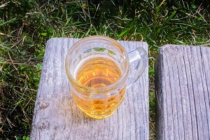 Mug of beer on a bench