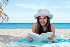 girl on the beach with book