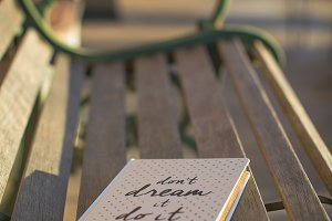 Writing journal on wooden bench