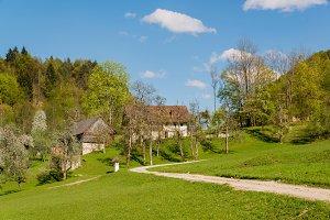 Hayracks, kozolec and old farm