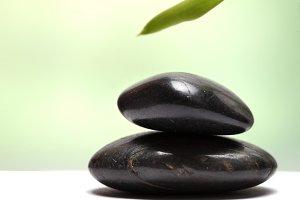 black stones with leaf