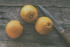 Oranges on rustic wooden table