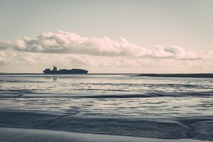 Passing container ship