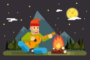 Traveler Plays Guitar at Night Camp