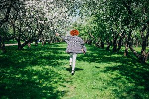 Girl walking in the park. spring