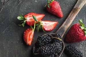 Berries on dark wooden background