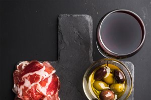 Glass of red wine & meat appetizer
