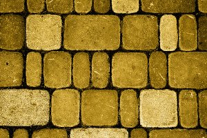 Texture of golden stone brick wall
