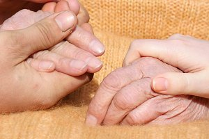 hands comforting elderly hands