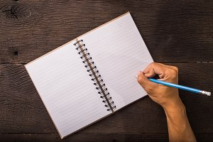 Writing on blank notebook