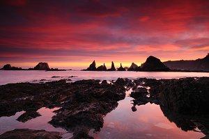 Sunrise at coastline.