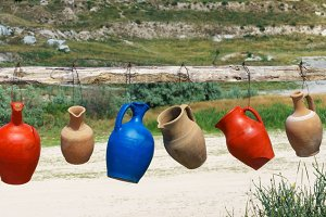 Colorful clay jugs hanging in a line, Cappadocia, Turkey.