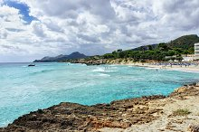 Rocky beach with beautiful turquoise sea water and  mountain, Majorca, Spain
