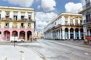 Panoramic view of Havana street with crumbling buildings at sunny day