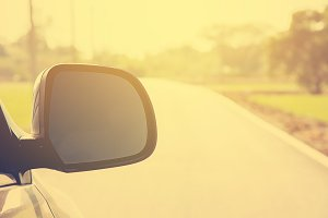 side view mirror car on the road.
