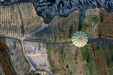 top view of the air balloon over fields, mountains and road, Cappadocia, Turkey