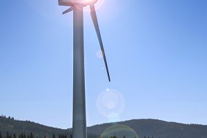 Wind turbine with sky and sun