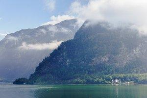 Morning Mountain Mist near lake. Summer mountain view in fog.