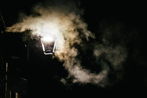 Steam in a street at night