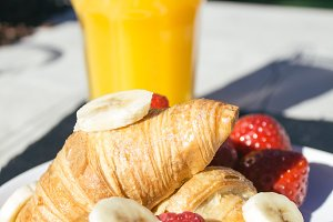 Croissants with berries and bananas
