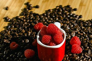 Red cup with raspberries