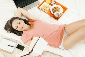 Woman reading the book in bedroom