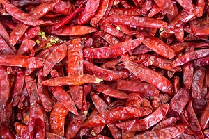 Lot of dried hot red chili pepper at vegetable stall
