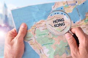 Man consulting map of Hong Kong