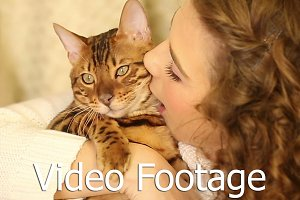 Girl kisses Bengal cat. Pet