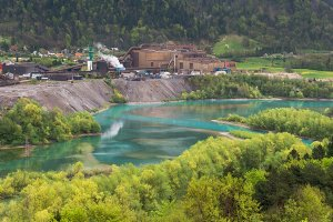 Steel factory over an emerald river