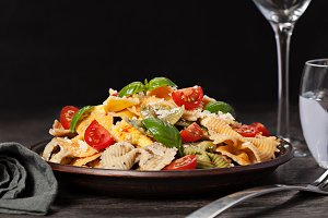 Multicolored pasta on dark background