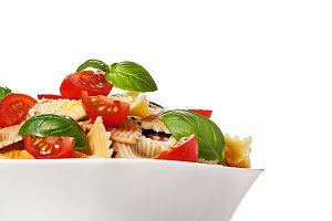 Multicolored pasta on light background