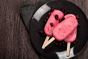 Strawberry popslice icecream on dark background