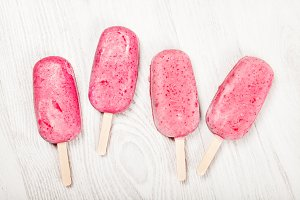 Strawberry popslice icecream on light background