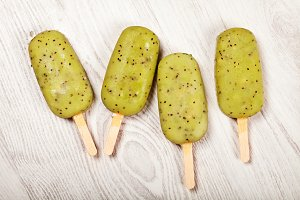 Kiwi popslice icecream on light background