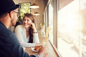Happy young couple at coffee shop