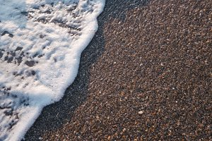 Sea foam and sand