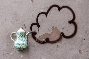 Decorative teapot on the wall