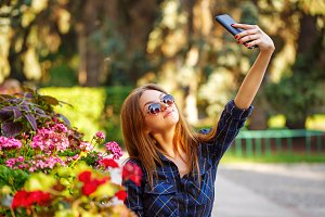 Girl in sunglasses making selfie