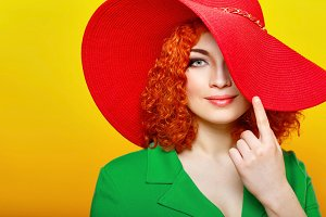 Red-haired girl in red shady hat