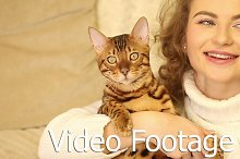 Girl speaks and kissing Bengal cat