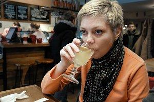 Blond short hair woman eats