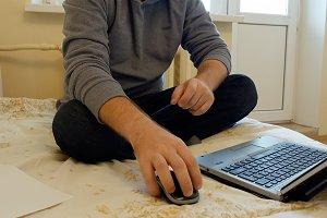 Man focused at work or social media on his laptop