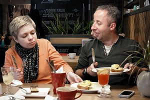 Couple man woman eats talks and tries a new dish
