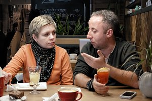 Couple man and woman eats talks in cafe restaurant