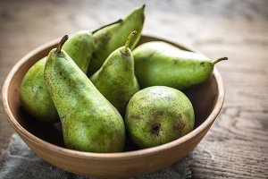 Fresh pears in the rustic bowl