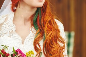 Red hair bride with flowers