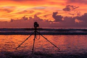 Camera on sunset sky
