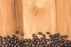 Roasted coffee bean on wood table